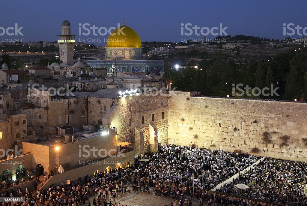 Praying at the Wailing Wall in Jerusalem stock photo