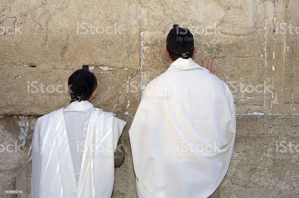 Praying at the wall stock photo