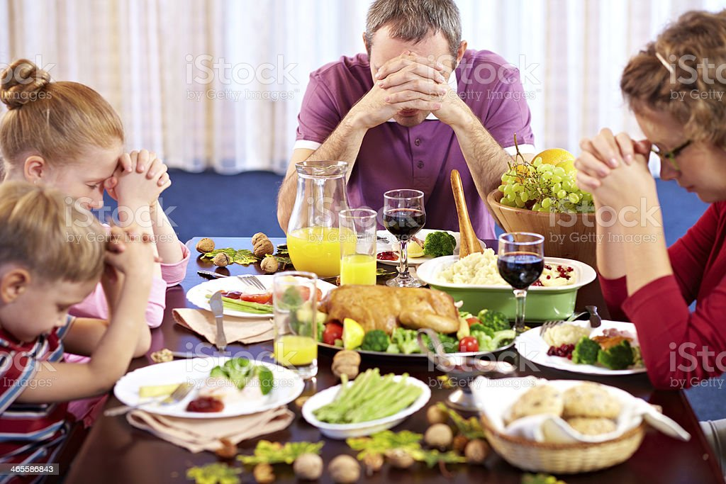Praying before meal royalty-free stock photo