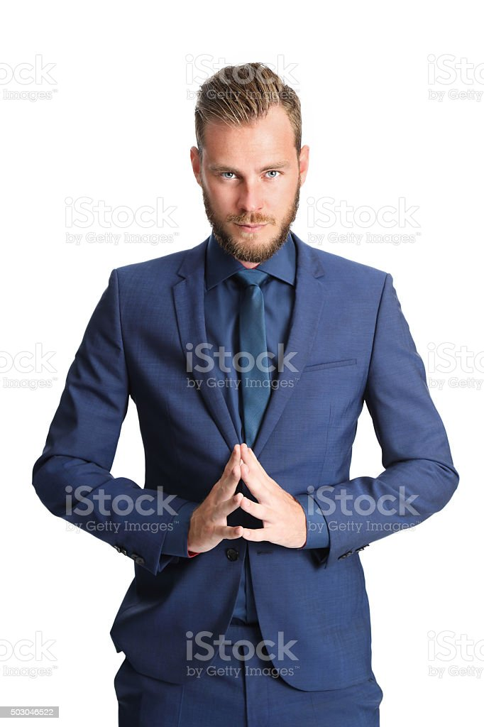Praying businessman in suit stock photo