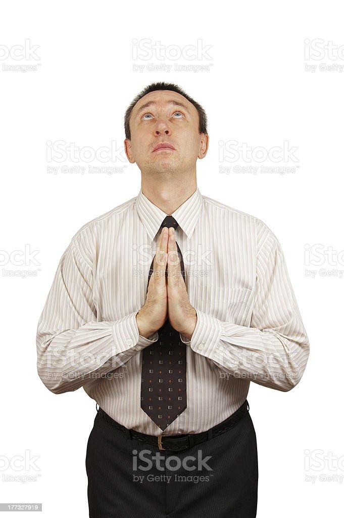 Praying businessman stock photo
