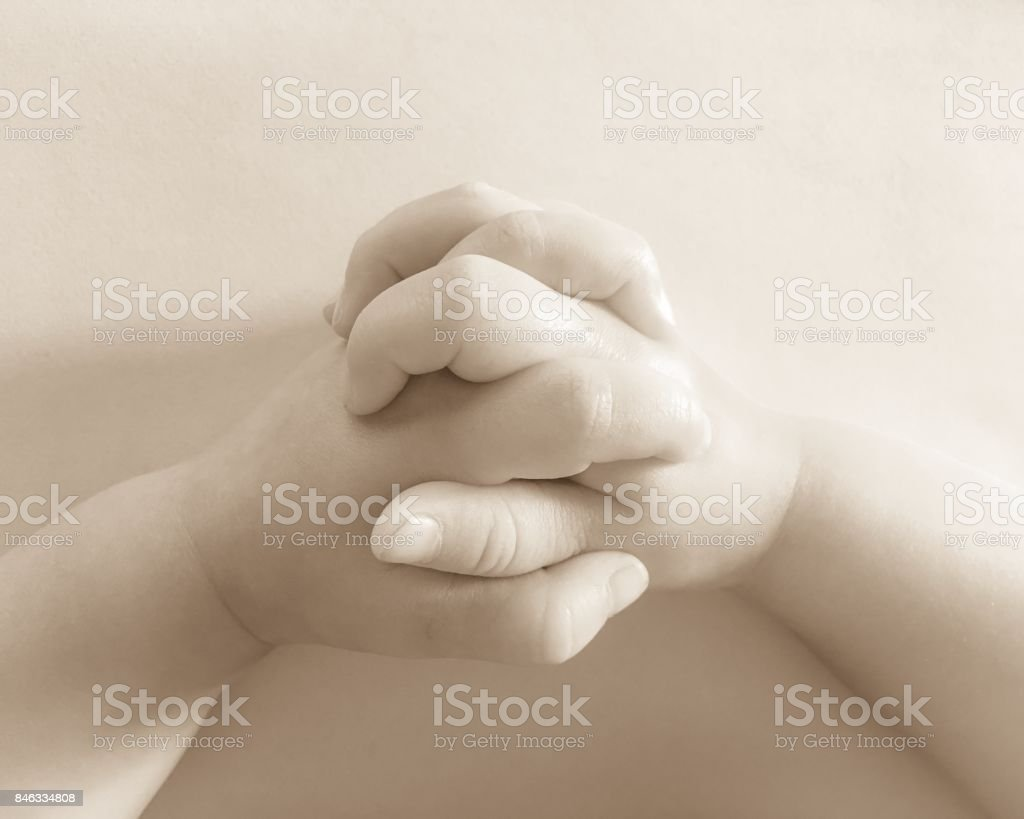 praying child hand stock photo