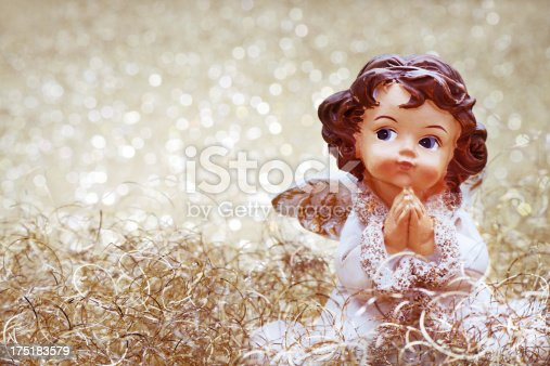 Praying christmas angel with illuminated copy space. This is a mass produced ornament.