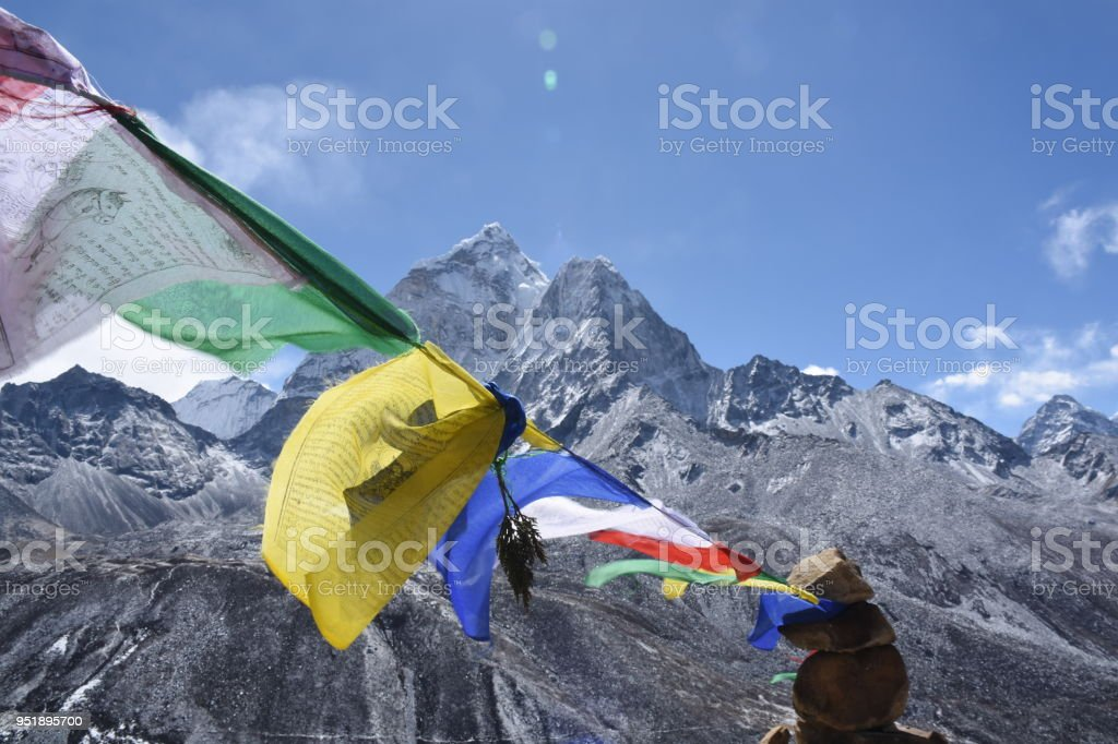 Praying flag in front of Ama Dablam, Nepal stock photo