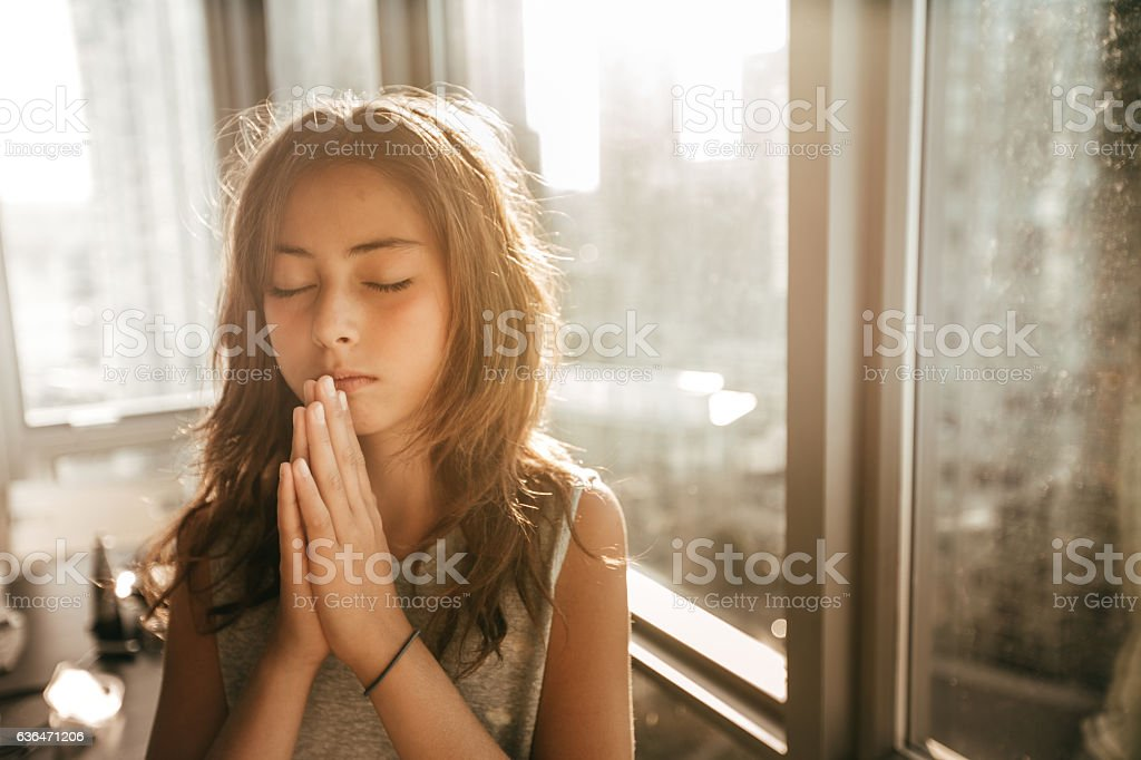 Praying for my soul stock photo