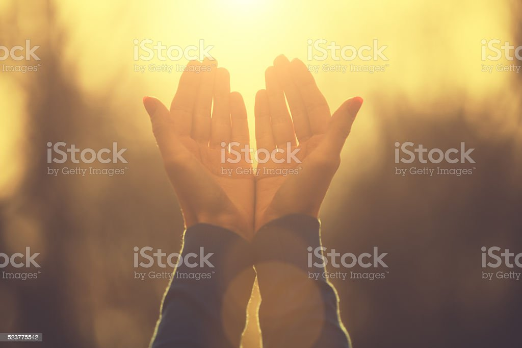 Praying for the sun. stock photo