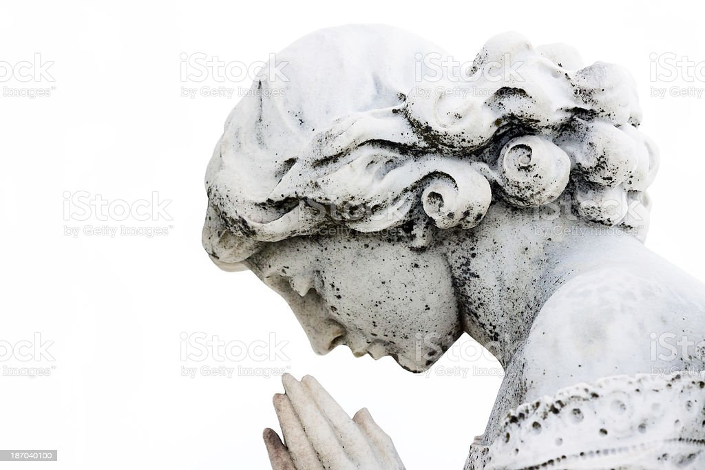 Praying girl, old marble statue against white background, copy space royalty-free stock photo