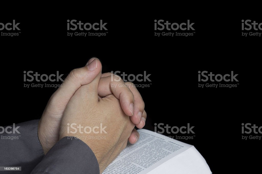 Praying hand with holy bible royalty-free stock photo