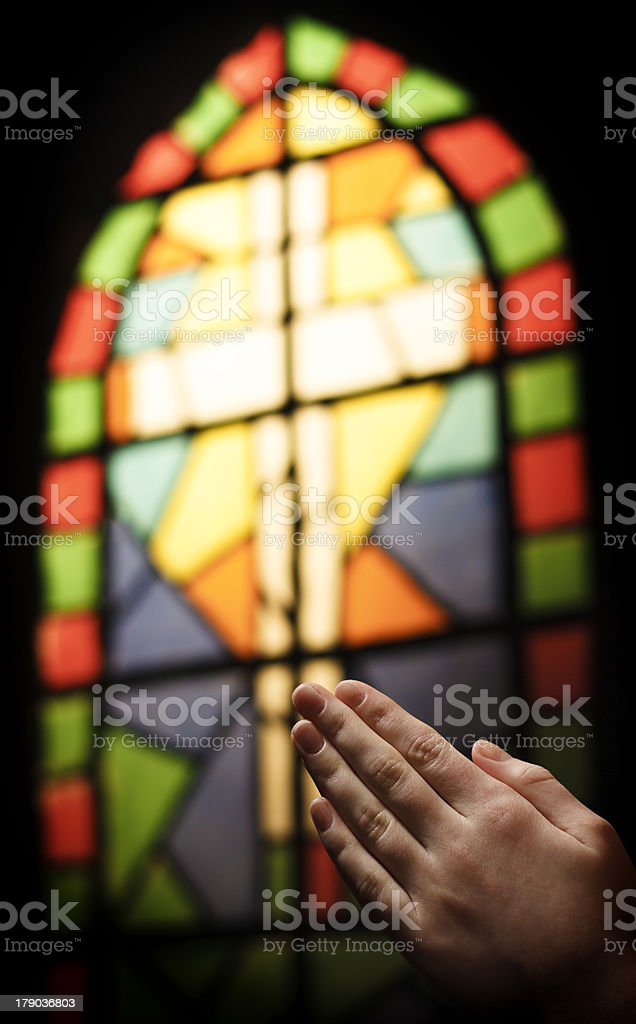Praying Hands And Stained Glass Church Window royalty-free stock photo