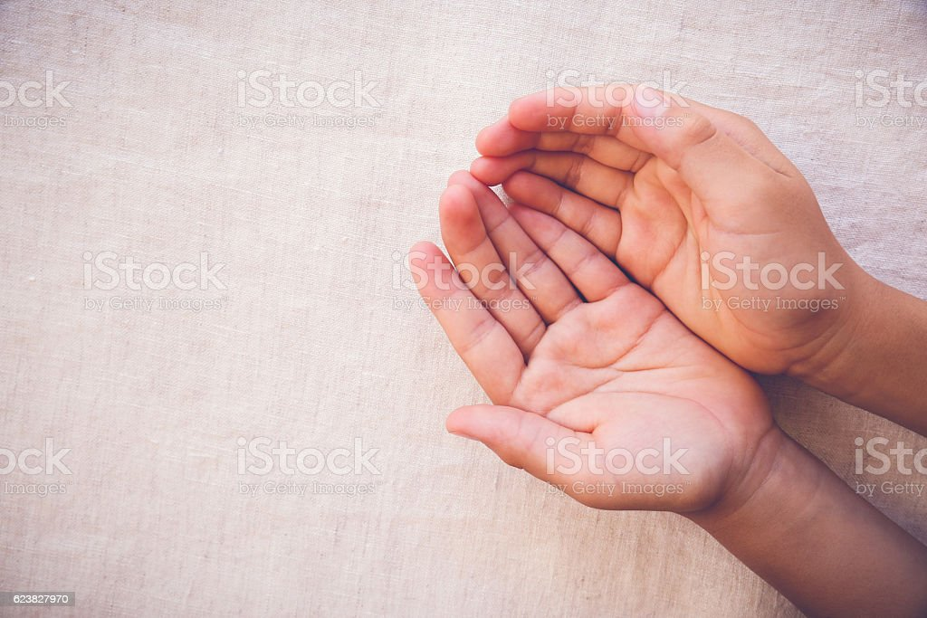 praying hands on toing copy space background stock photo