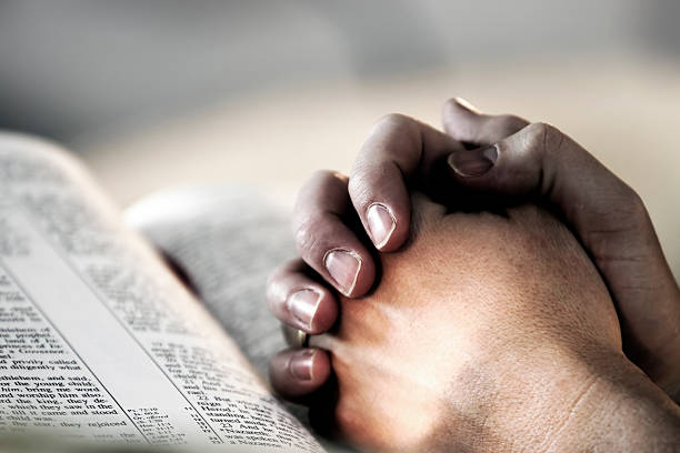 Praying hands over a holy bible picture id139861059?b=1&k=6&m=139861059&s=612x612&w=0&h=fo5nfhxcllafnyorc axs jiheq0ay7ezxvcapfvwdq=