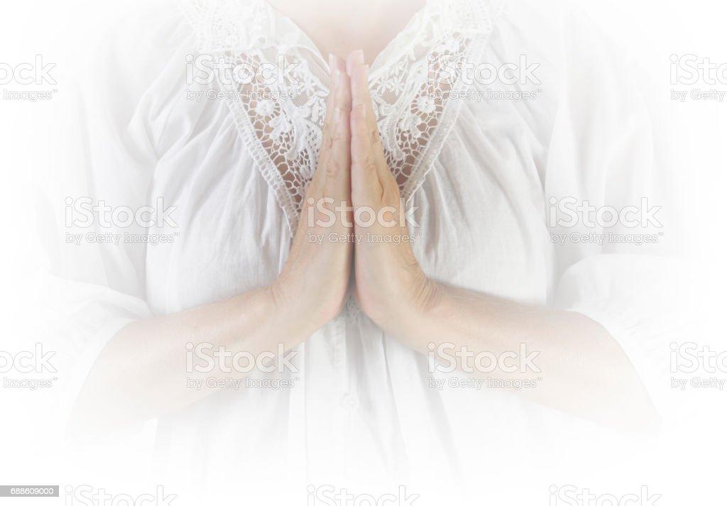 Praying Hands Saying Grace stock photo