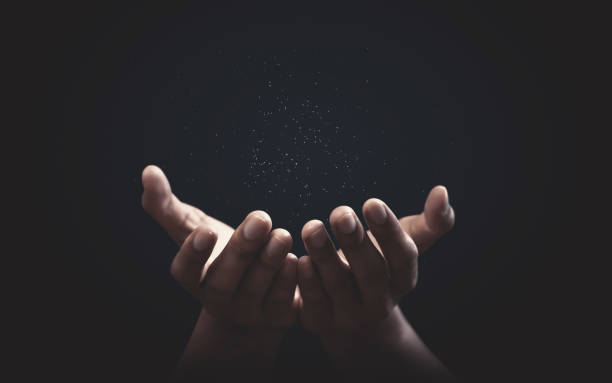 Praying hands with faith in religion and belief in God on blessing background. Power of hope or love and devotion. stock photo