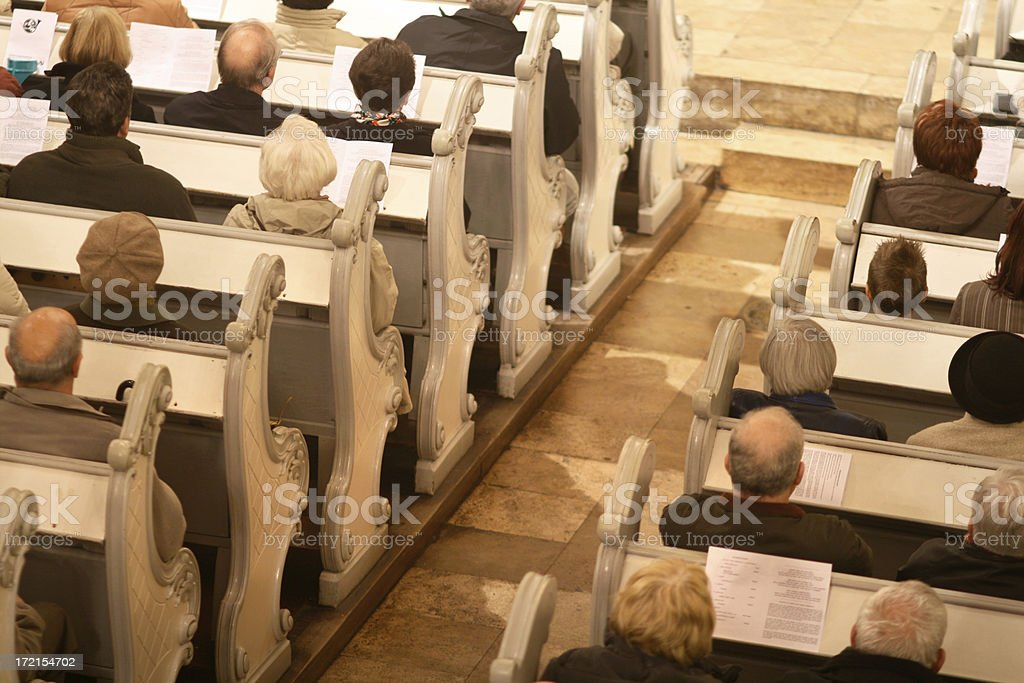 Praying in a church royalty-free stock photo