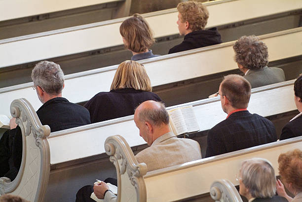 Praying in a church People Praying in a church pew stock pictures, royalty-free photos & images