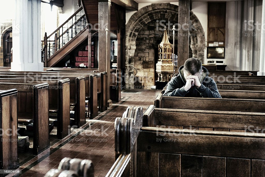 Praying in an Anglican church, UK royalty-free stock photo
