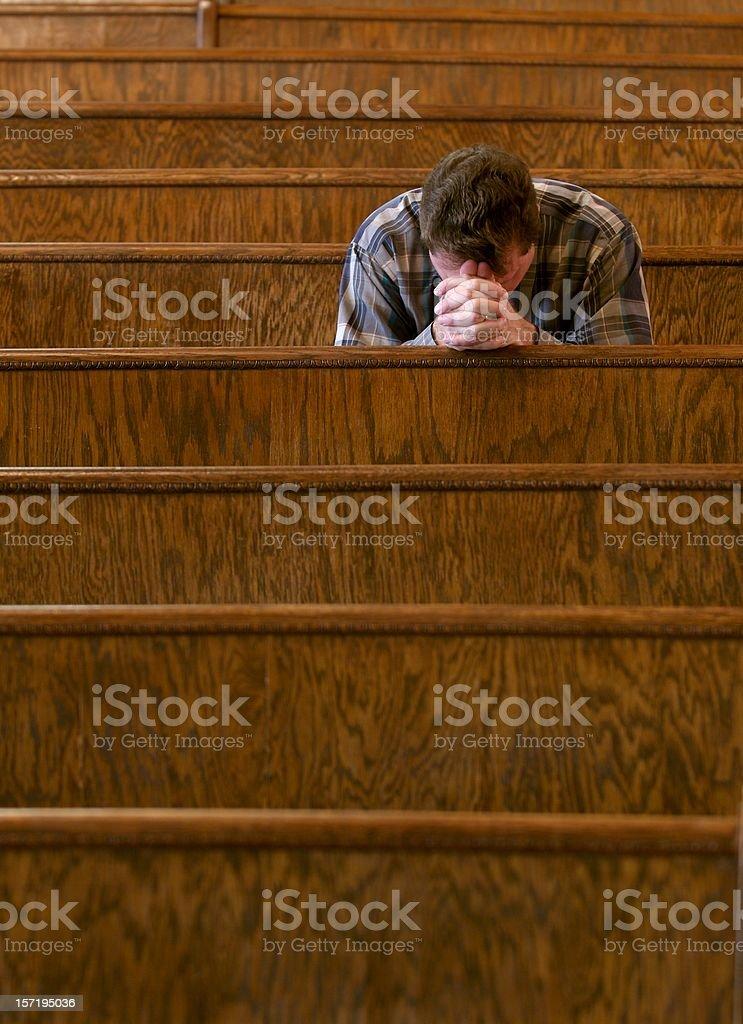 Praying in Church stock photo