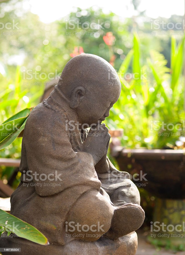 Praying in the Garden royalty-free stock photo