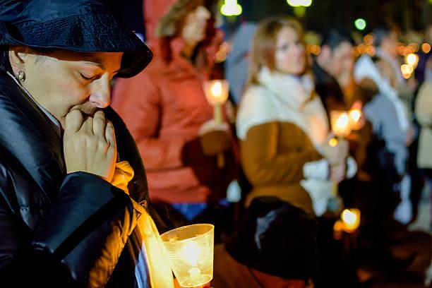 praying in the shrine of fatima stock photo