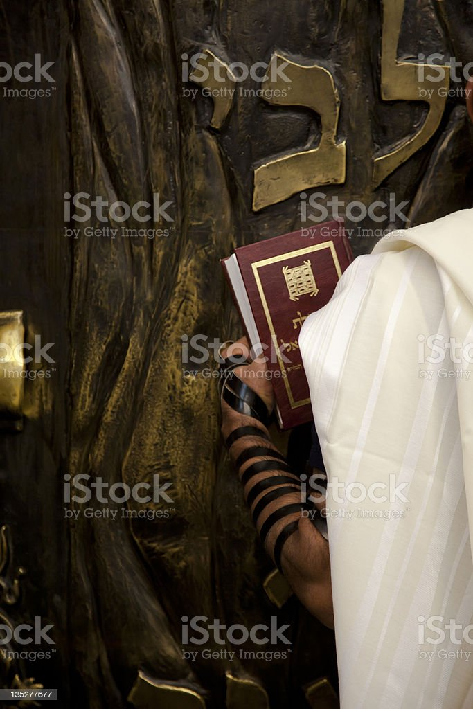 Praying infront of the Bible Cabinet stock photo