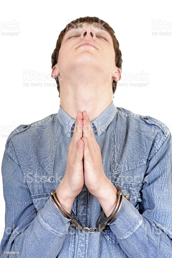 Praying Man in Handcuffs royalty-free stock photo