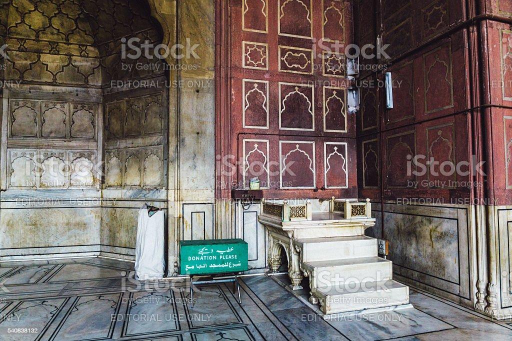 Praying man in Jama Masjid Mosque stock photo