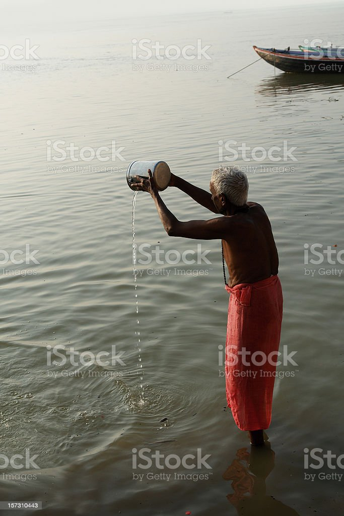 Praying Man in the Ganges River royalty-free stock photo