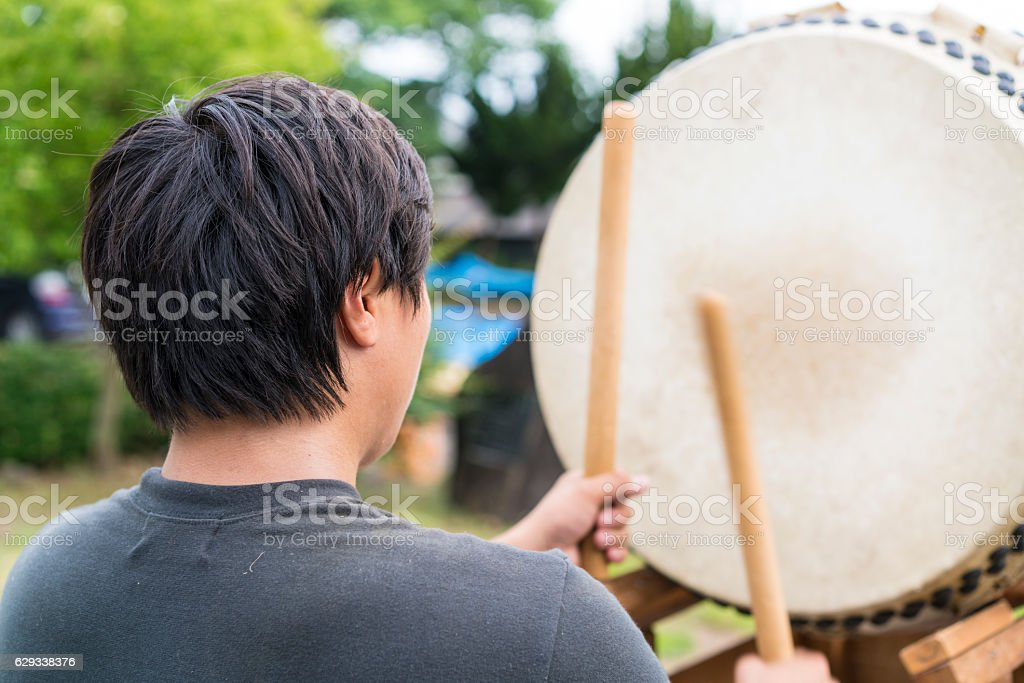 Praying man on traditional Japanese drum Taiko, Tsukuba, Japan stock photo