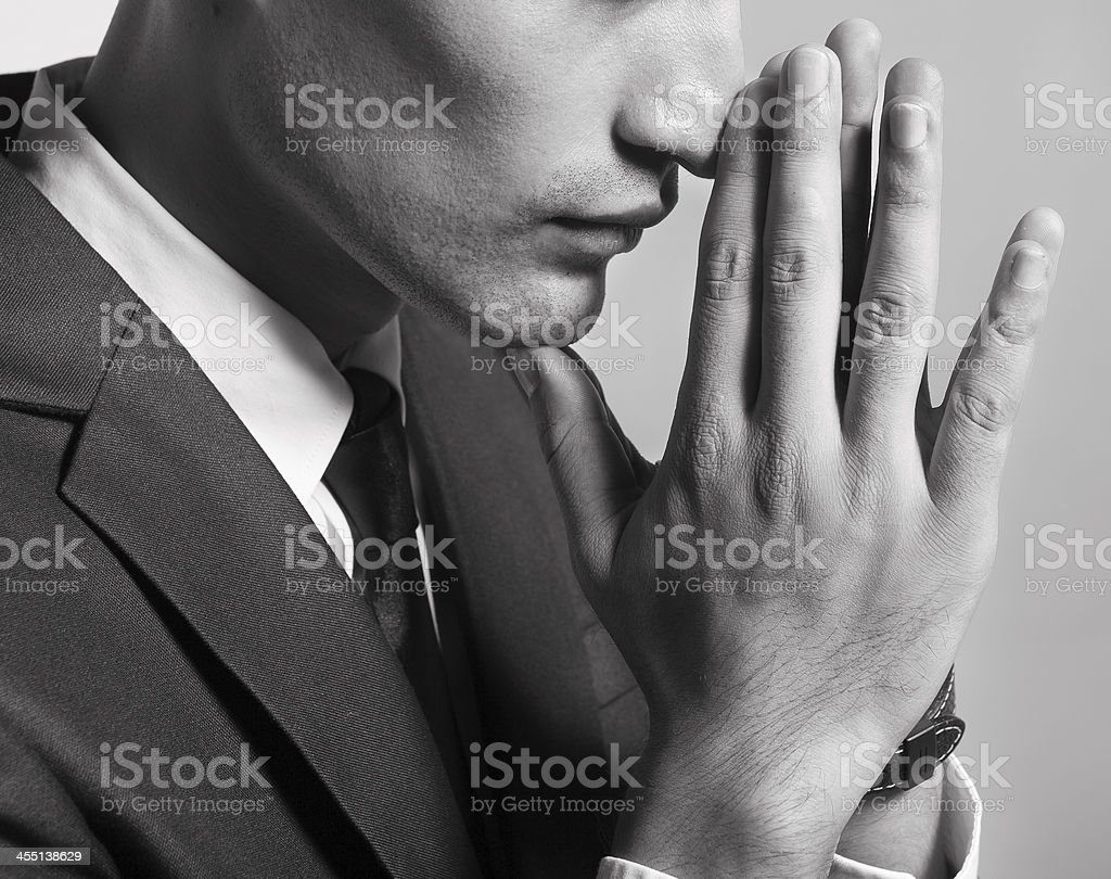 Praying man stock photo