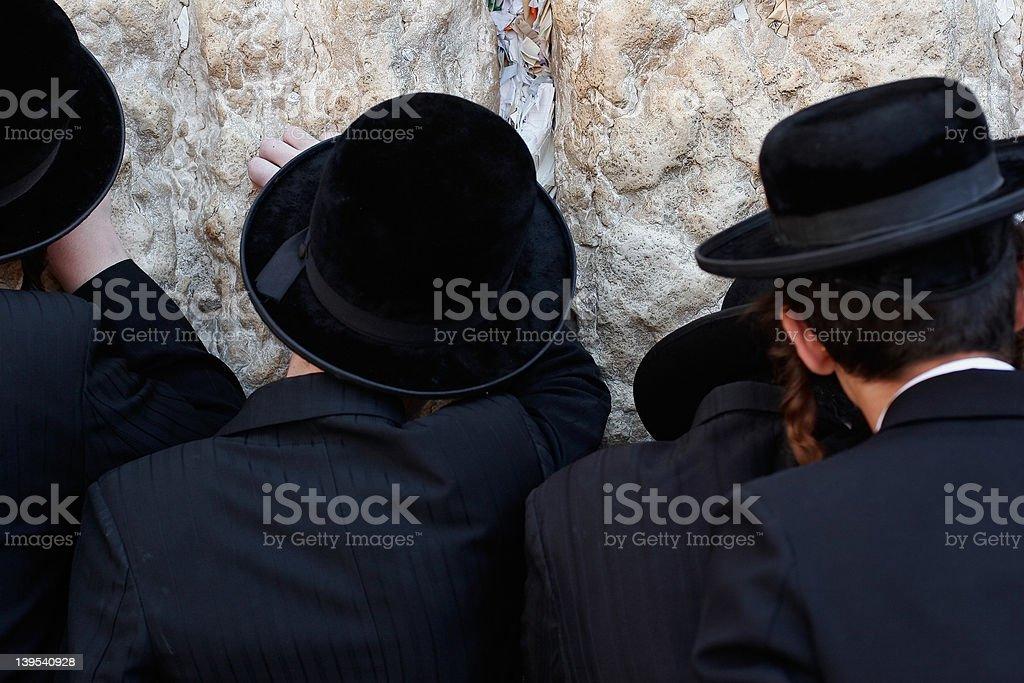 Praying men royalty-free stock photo