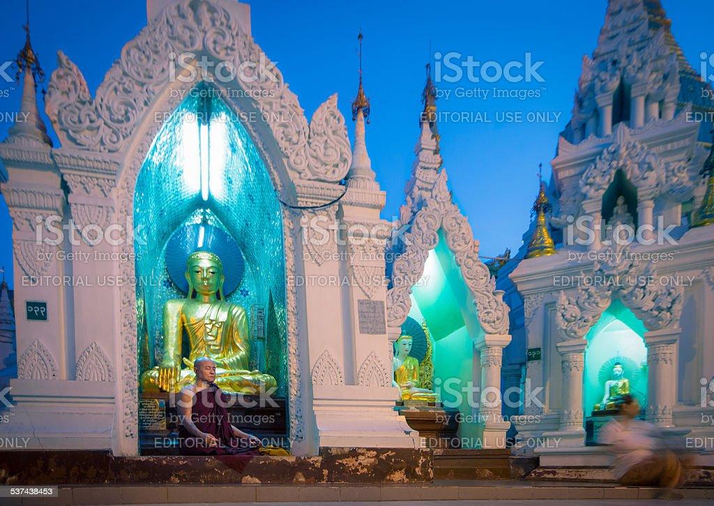 Praying Monk at Schwedagon Pagoda stock photo