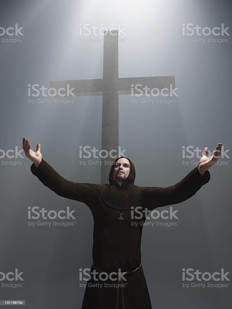 praying monk before a cross royalty-free stock photo