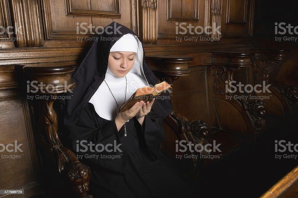 Praying novice nun stock photo