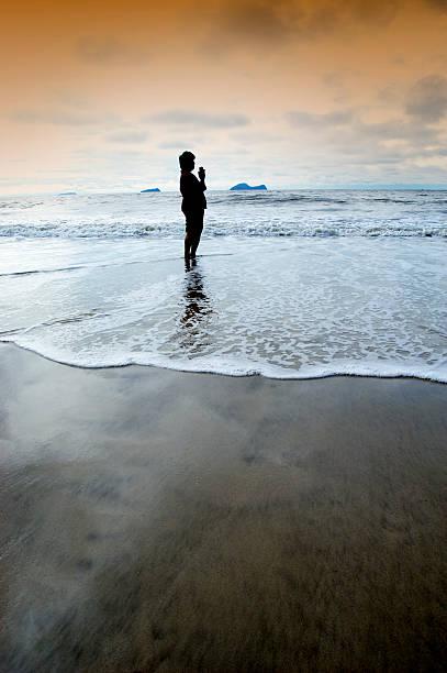 Beten am Strand – Foto