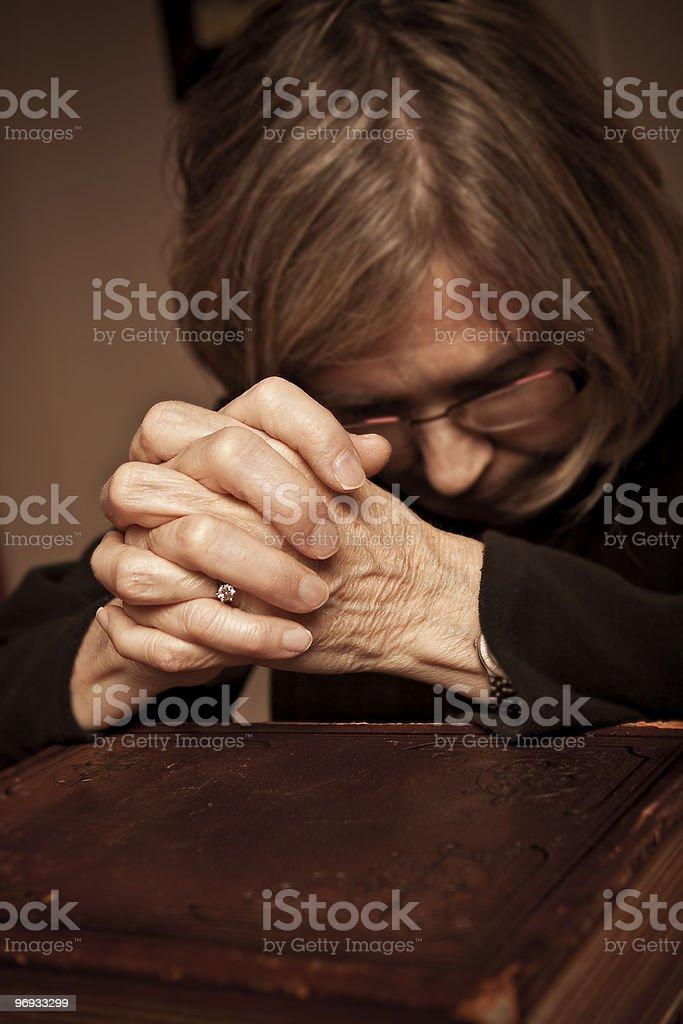 Praying on the Bible royalty-free stock photo