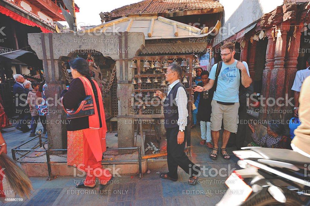 Praying on the streets of Kathamandu royalty-free stock photo