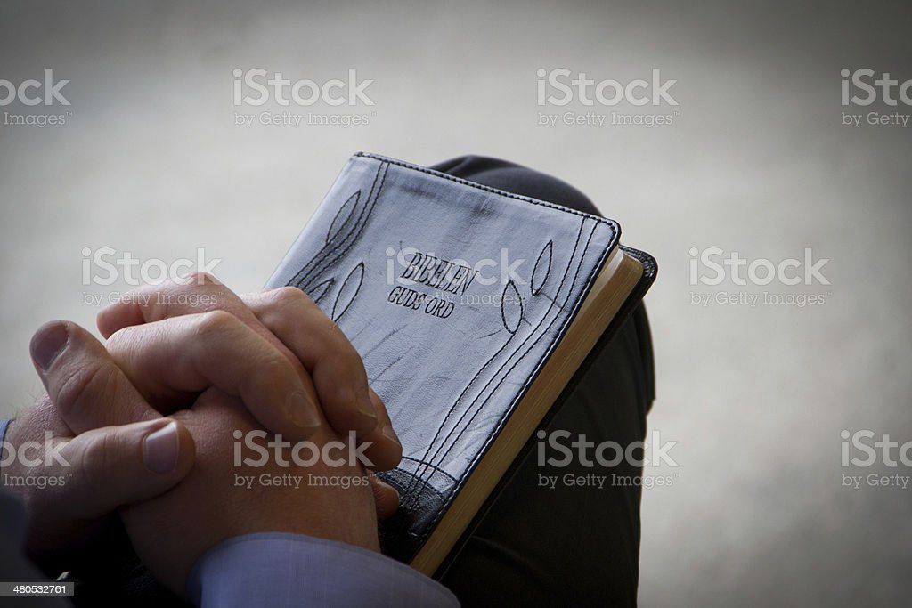 Praying over Bible royalty-free stock photo