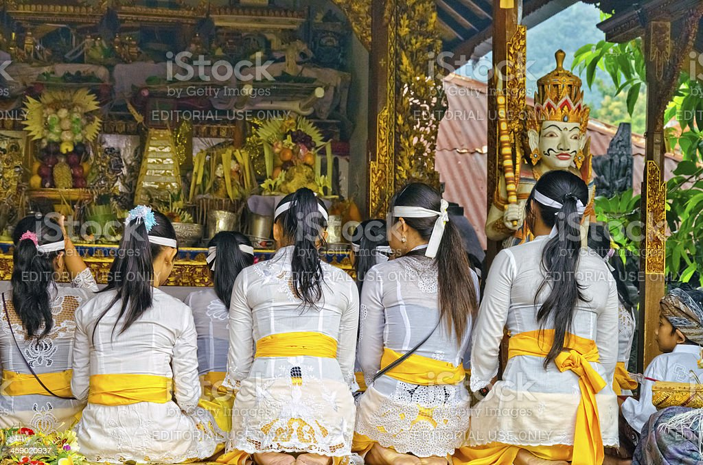 Praying people at a hindu temple in Bali - Indonesia royalty-free stock photo