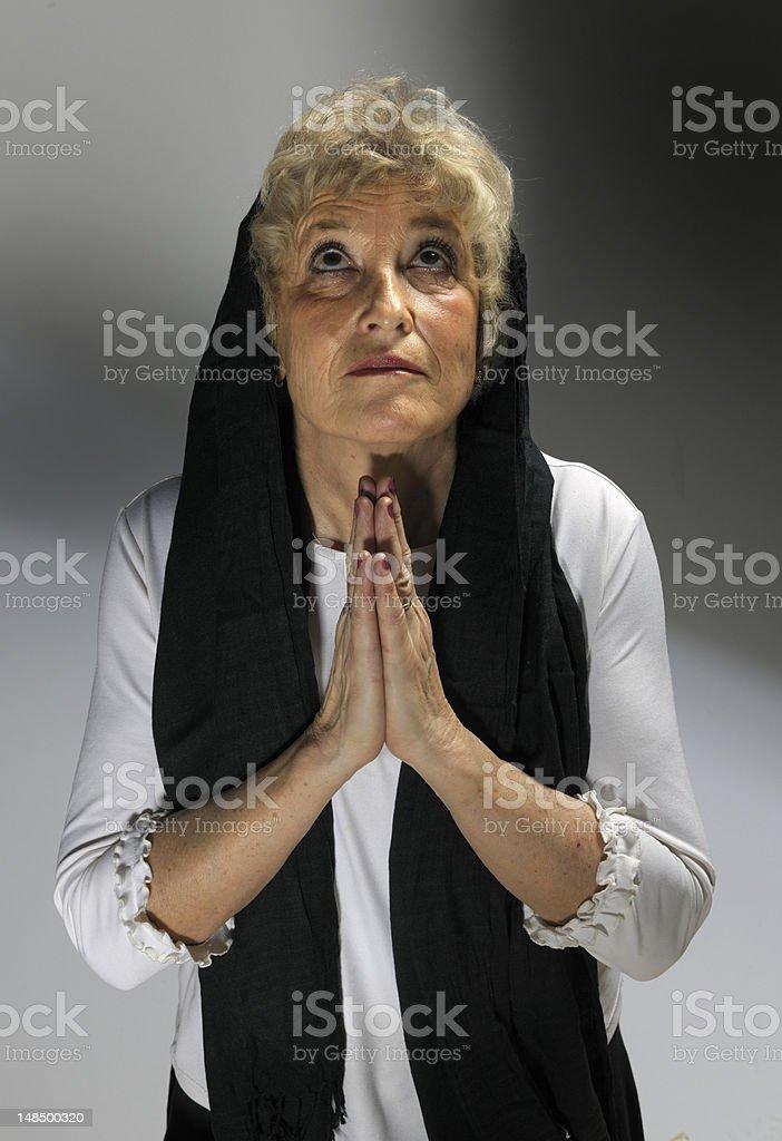 praying senior woman with veil royalty-free stock photo