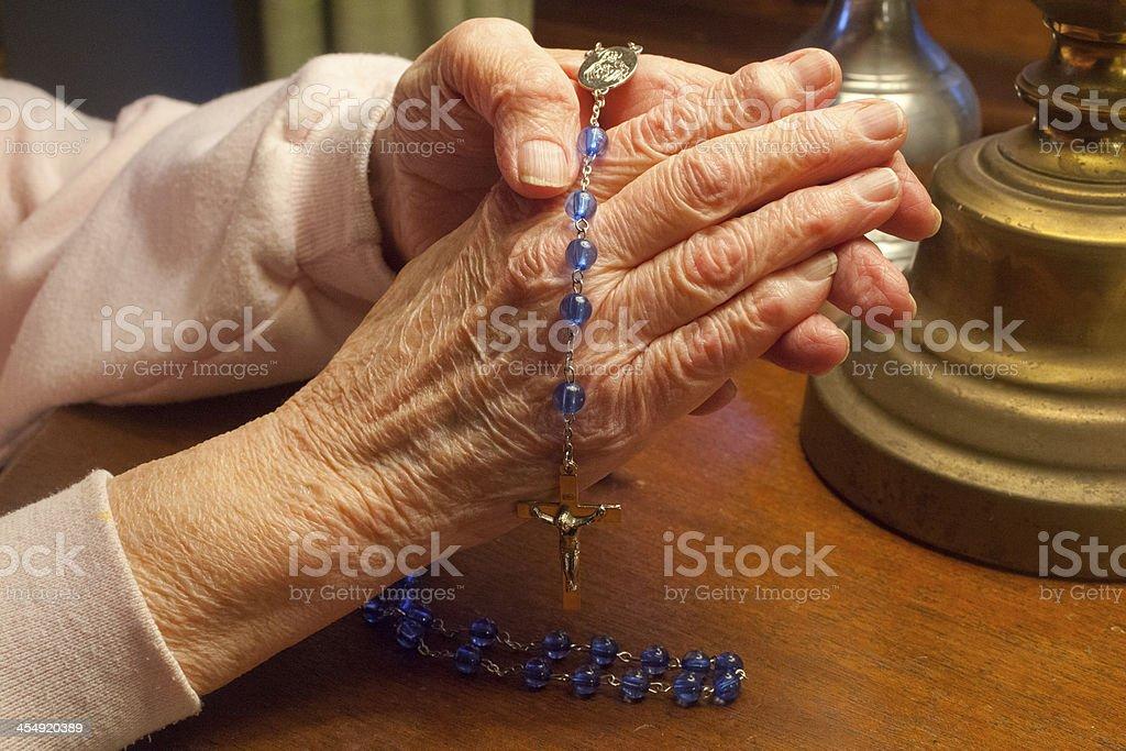 Praying The Rosary stock photo