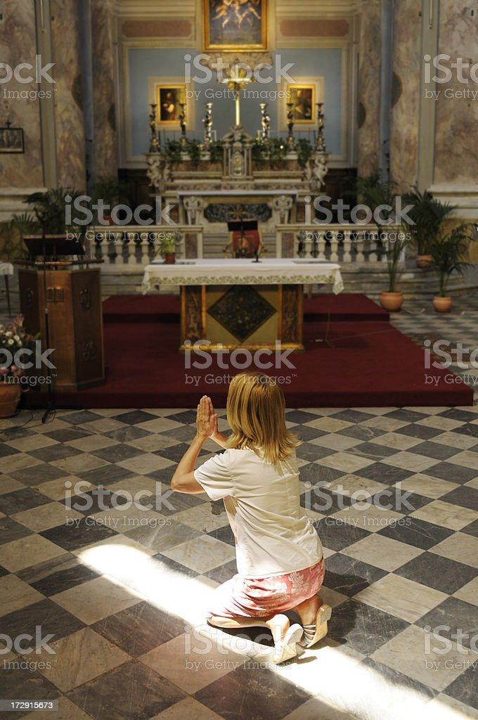 praying towards the light royalty-free stock photo