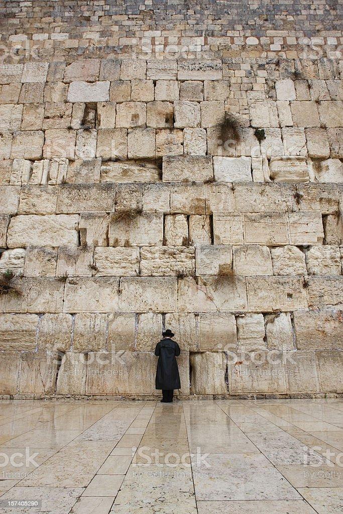 Praying Under Rain at the Western Wall royalty-free stock photo