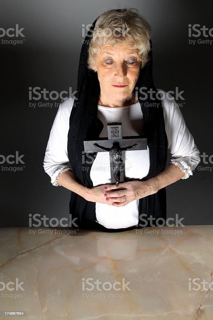 praying woman holding crucifix royalty-free stock photo