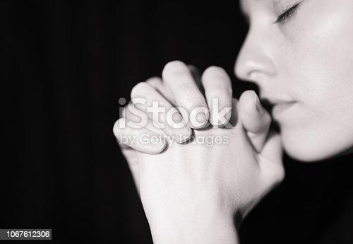 istock Praying woman 1067612306