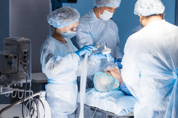 Pre oxygenation for general anesthesia. Surgery equipment Team of experienced doctors and assistants performing difficult abdominal surgery, using the chance to save patient s life, and there is no greater calling in the world than that. anesthetize stock pictures, royalty-free photos & images