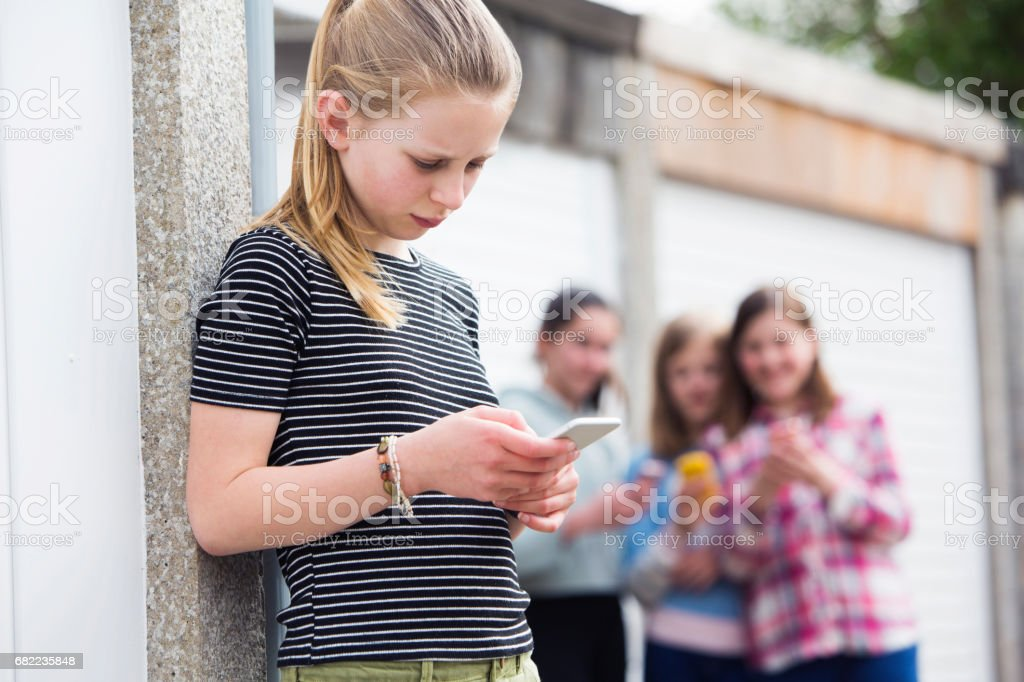 Pre Teen Girl Being Bullied By Text Message stock photo
