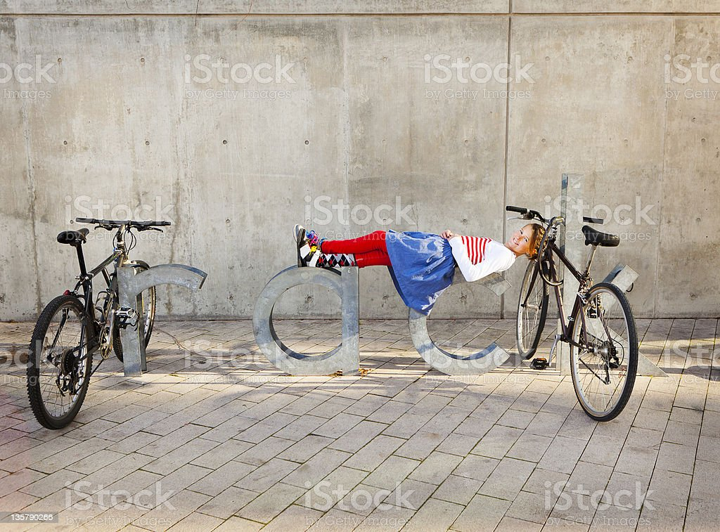 Pre Teen Laying on Big Letters 'RACK' royalty-free stock photo