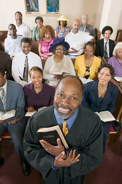 Preacher and Congregation stock photo