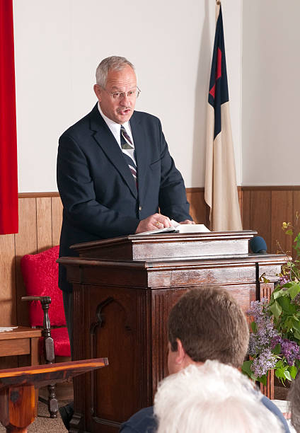Preacher Preacher preaching in a small church pulpit stock pictures, royalty-free photos & images