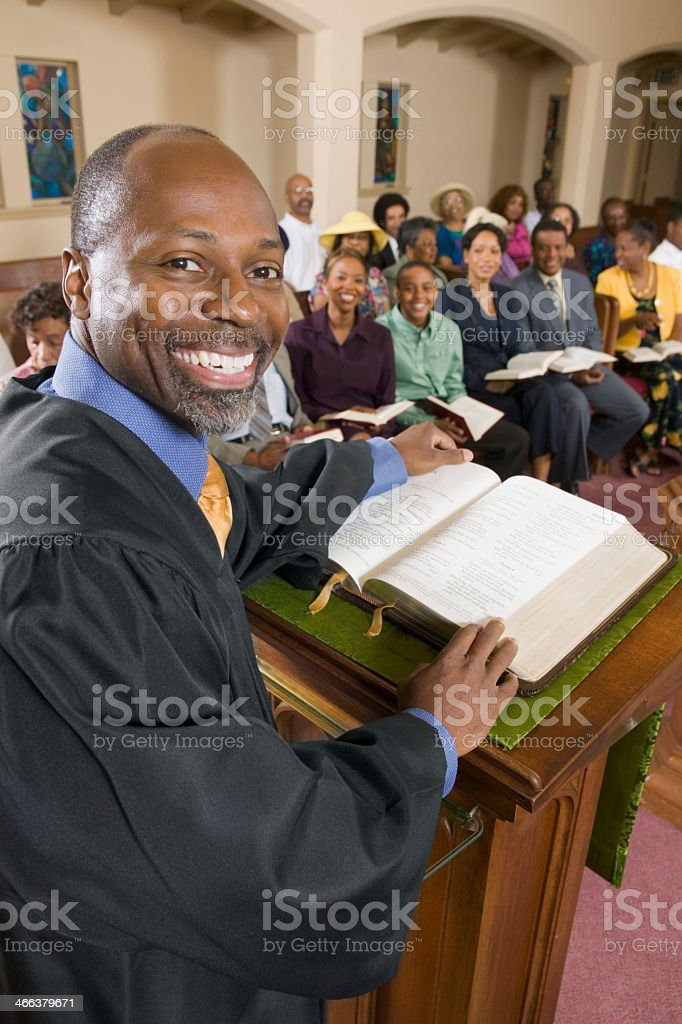 Preacher talking to his congregation in church stock photo